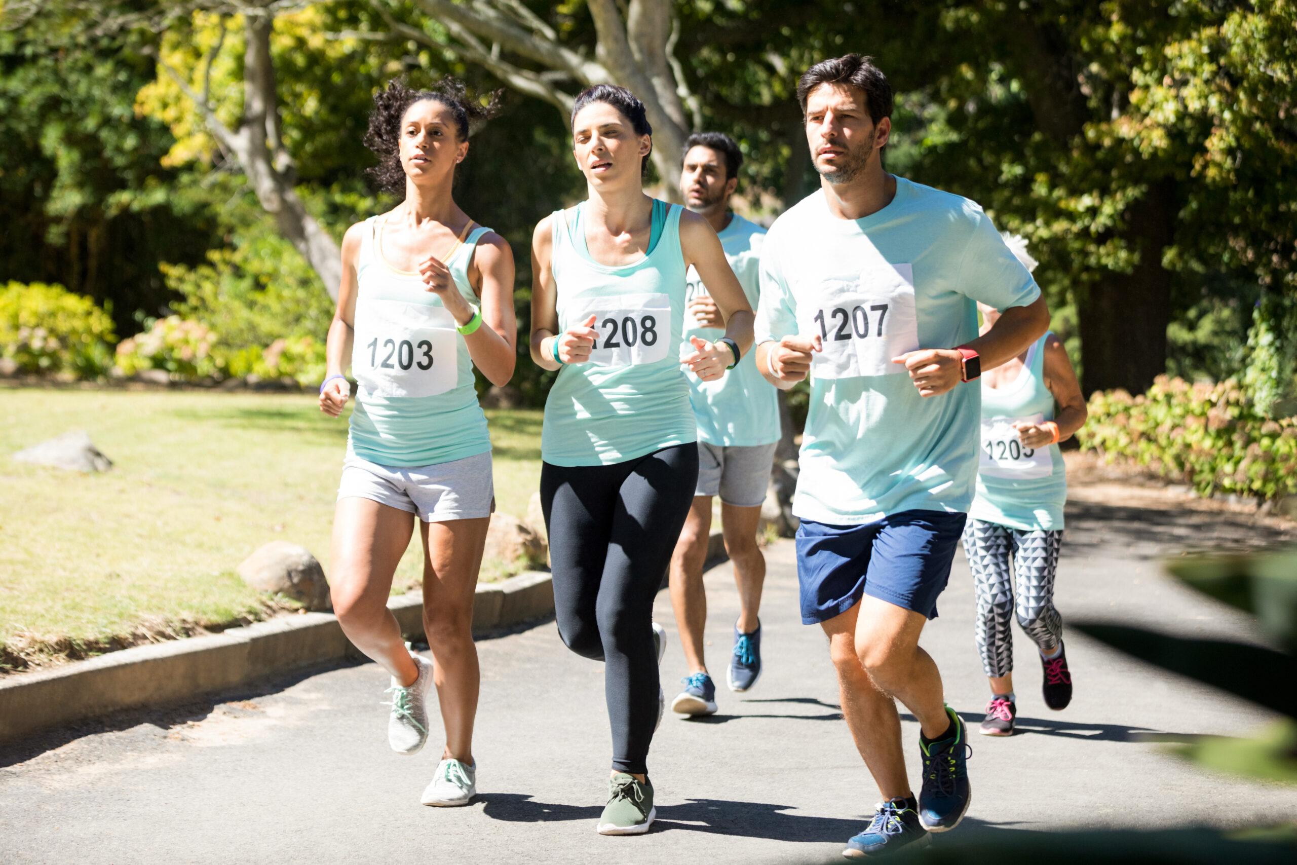 Determined marathon athletes running in the park